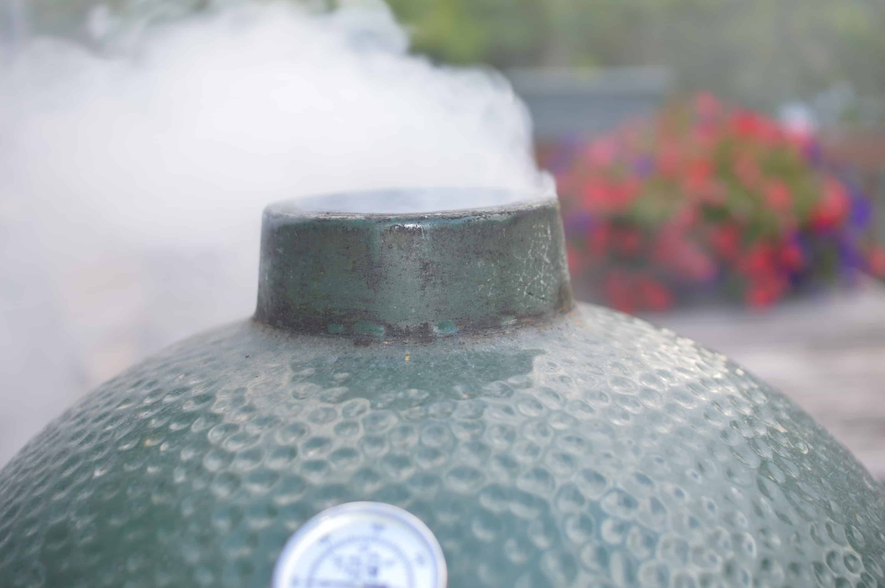 smoke billowing out of big green egg grill