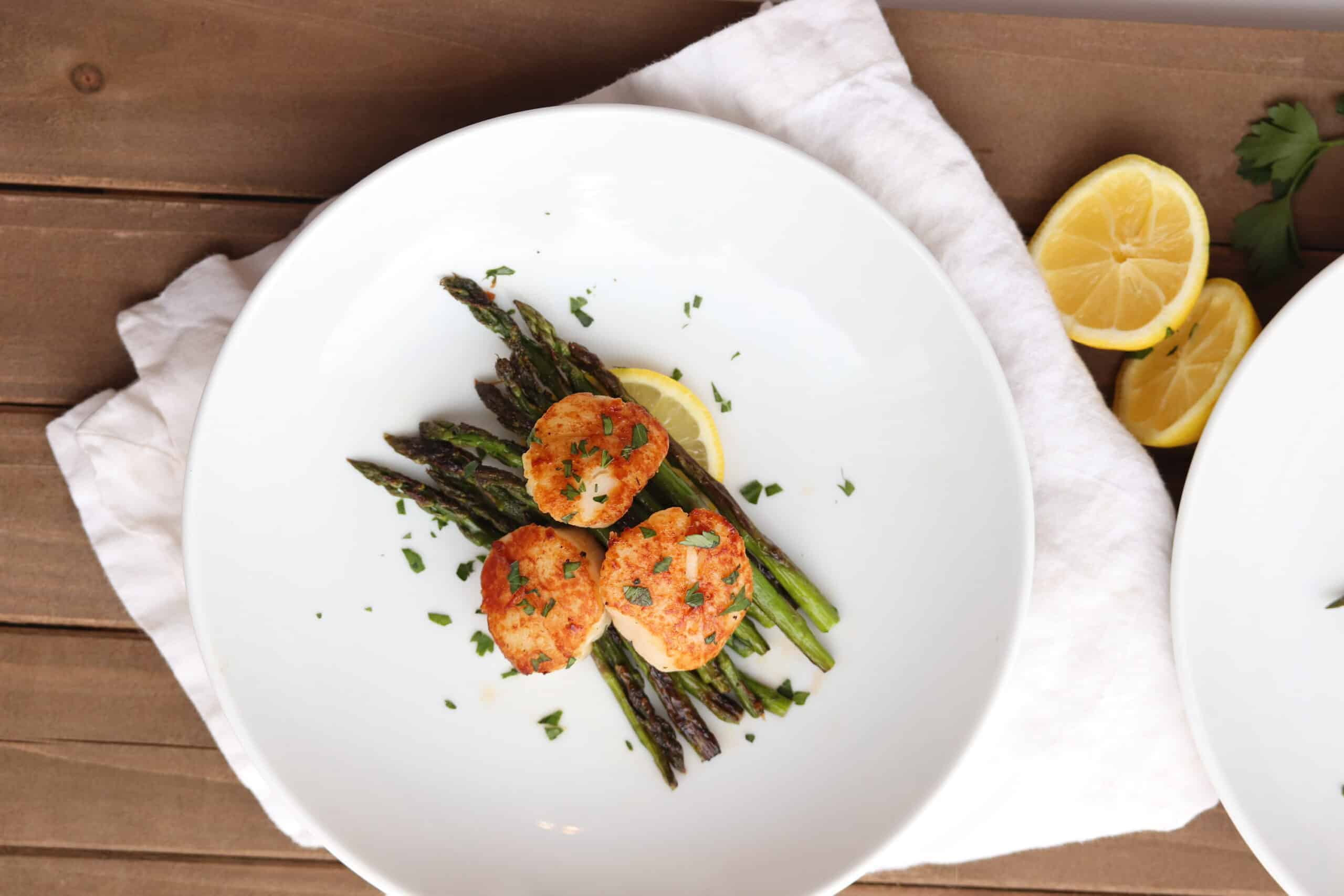 scallops and asparagus cooked on blackstone griddle